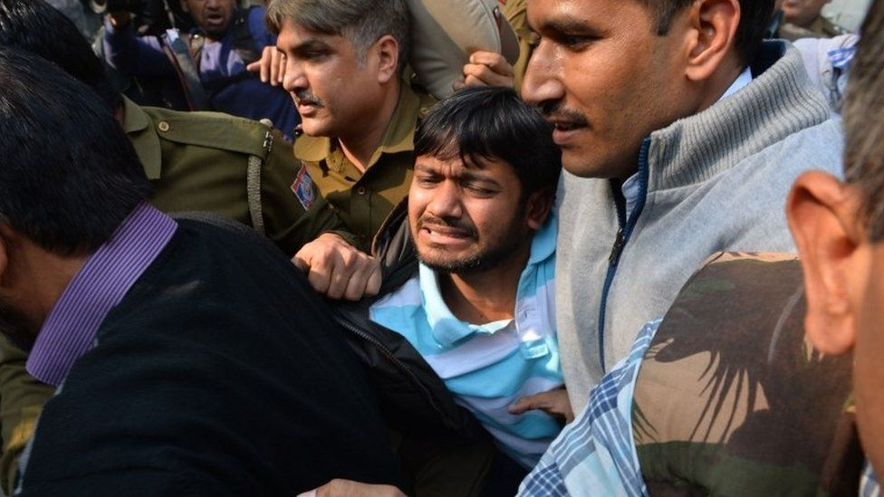 A file picture taken on February 17, 2016 shows Indian student union leader Kanhaiya Kumar (C) being escorted by police into Patiala Court for a hearing in New Delhi on February 17, 2016.