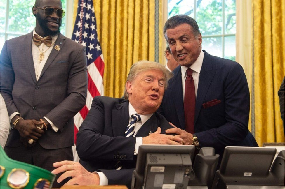 Actor Sylvester Stallone (right) and boxer Deontay Wilder (left) were present for the pardon signing.