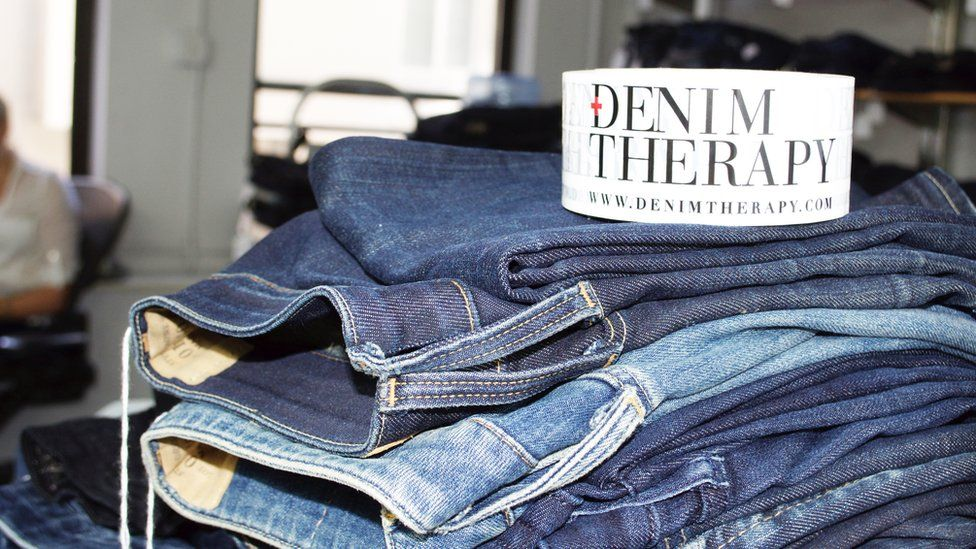 Jeans repaired by Denim Therapy