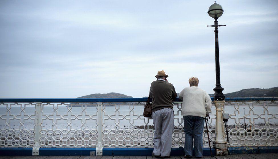 older couple on pier