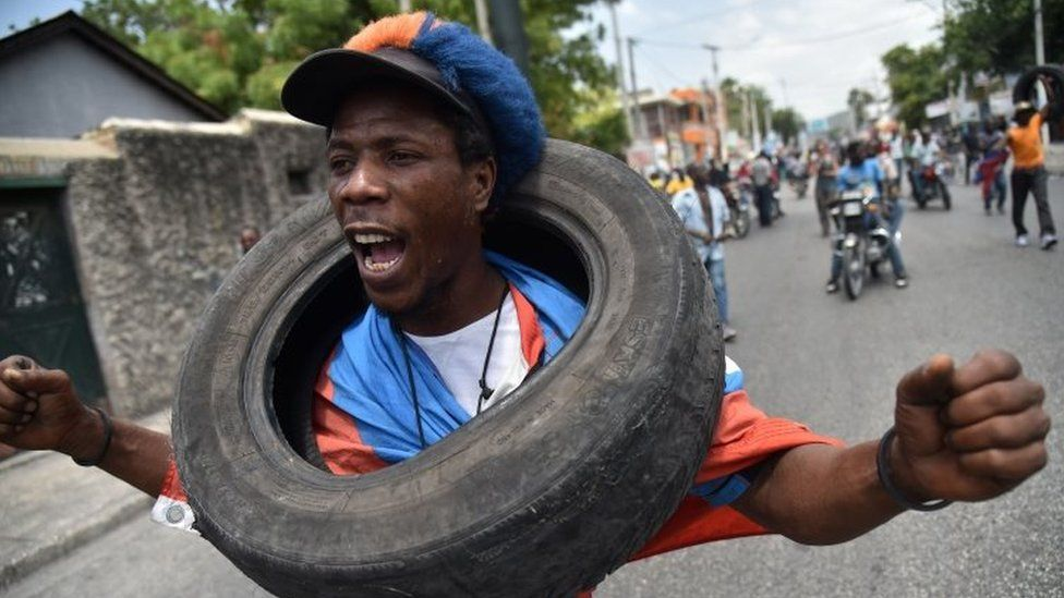 Demonstrators marched through the streets of Port-au-Prince, 14 July 2018