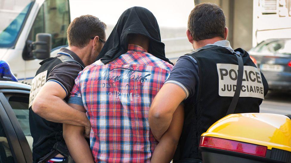 Suspect arrives at Marseille courthouse, 27 Jun 14