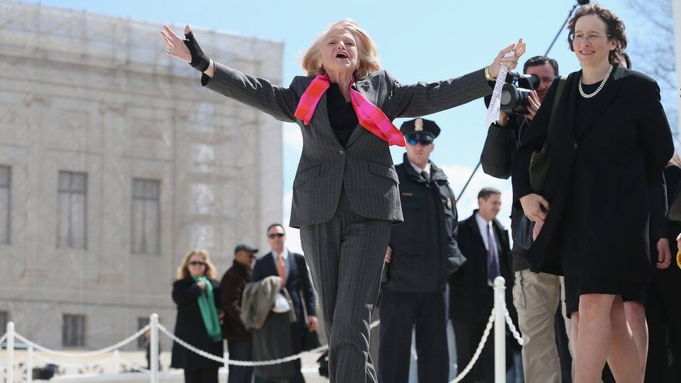 Edith Windsor, 83, acknowledges her supporters as she leaves the Supreme Court March 27, 2013 in Washington, DC.