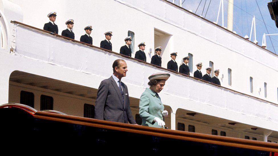 Queen Elizabeth II and the Duke of Edinburgh disembarking from the Royal Yacht Britannia in Portsmouth Dockyard in 1977