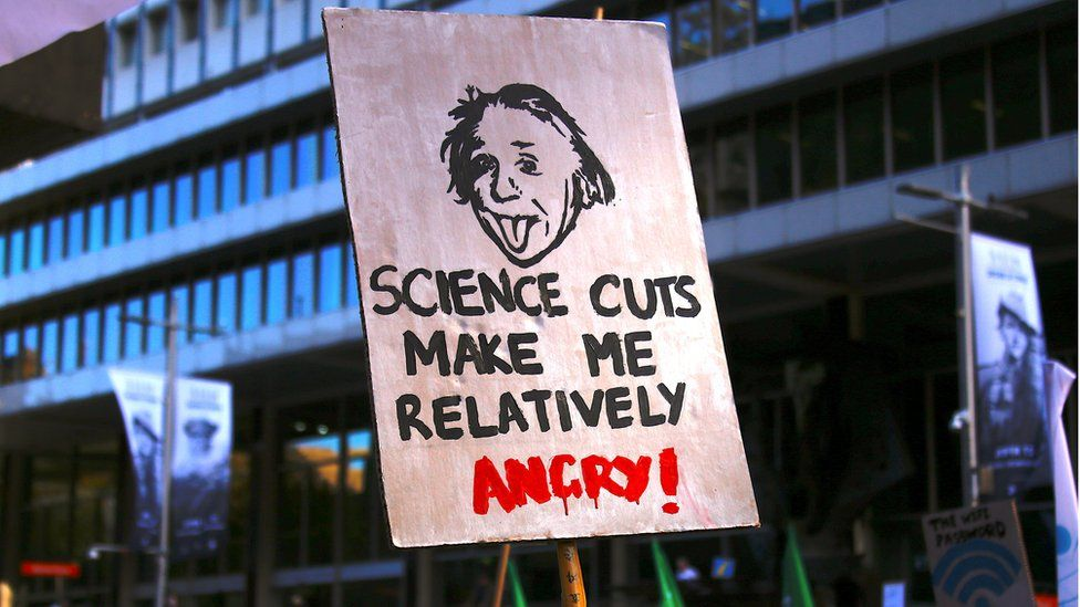 Protesters hold placards and banners as they participate in the March for Science rally on Earth Day, in Sydney, Australia, 22 April 2017