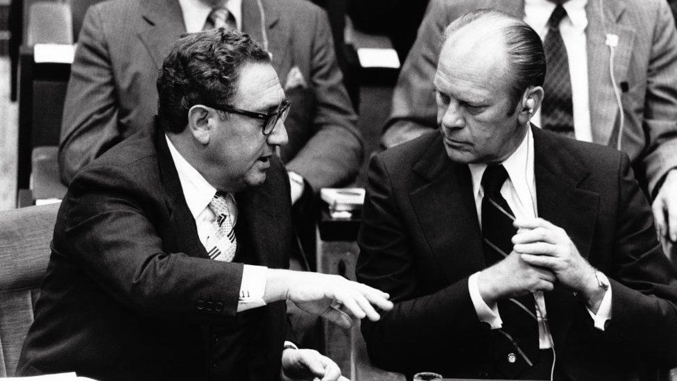 Henry Kissinger and President Gerald Ford at a summit in Paris