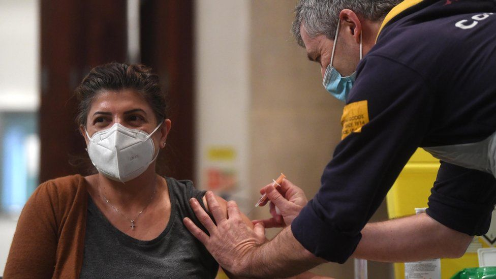 A woman receives the Oxford/AstraZeneca Covid19 vaccine at an NHS vaccination centre in Ealing, west London