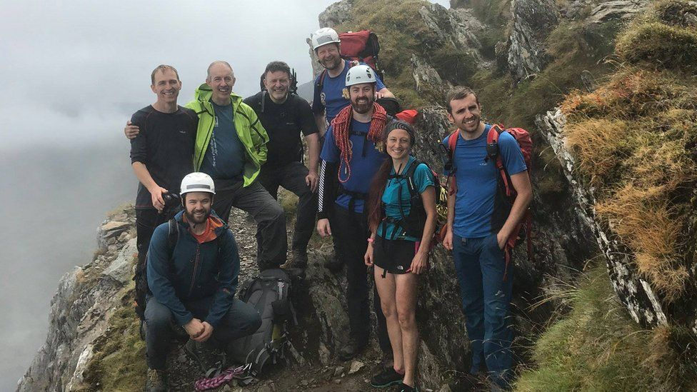 Eight members of the rescue team on a ridge