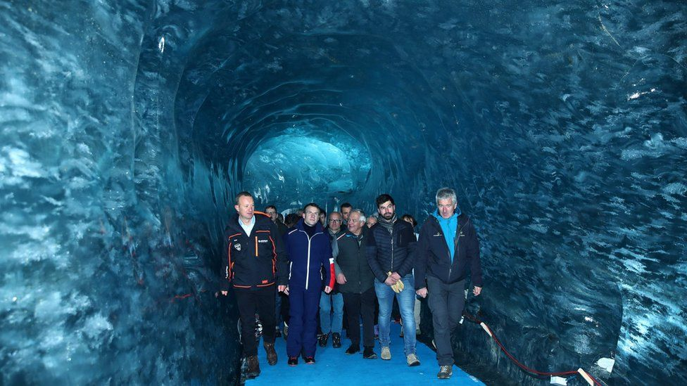 Emmanuel Macron visits Mer de Glace glacier with scientists and ministers