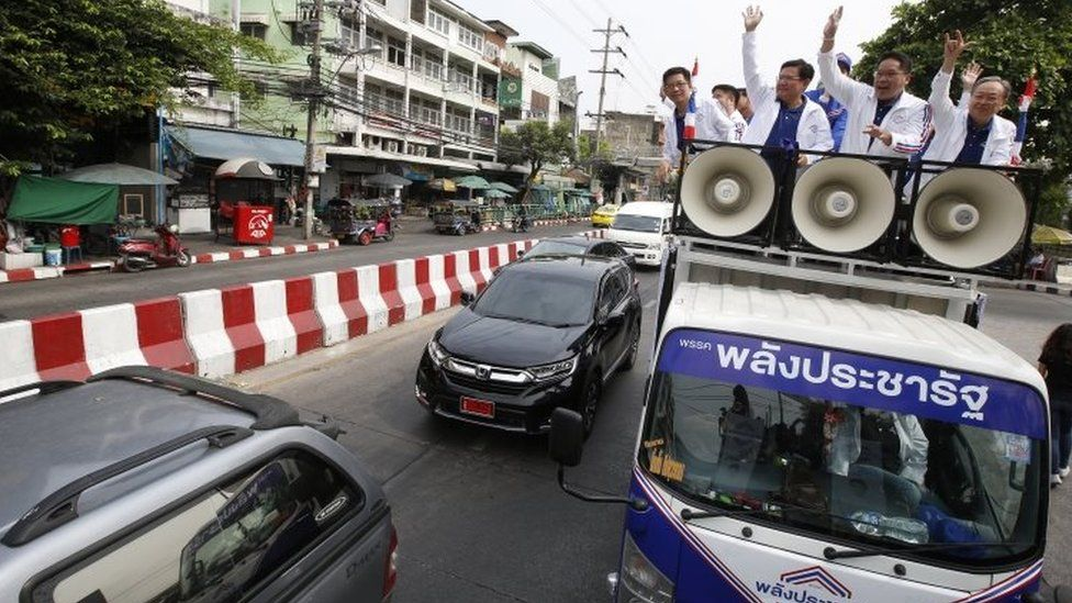 Leaders of the pro-junta political party Palang Pracha Rath travel through the streets on a vehicle to thank people who came out to vote for them