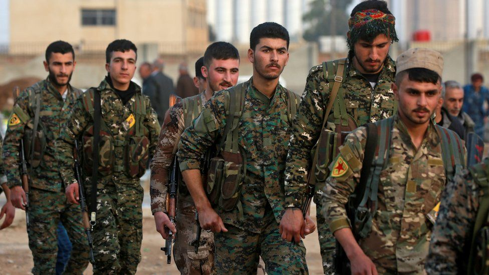 Members of the Kurdish People's Protection Units (YPG) attend a funeral in Qamishli (3 March 2018)