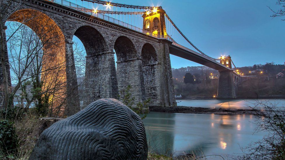 The Gorsedd stone and Menai Bridge