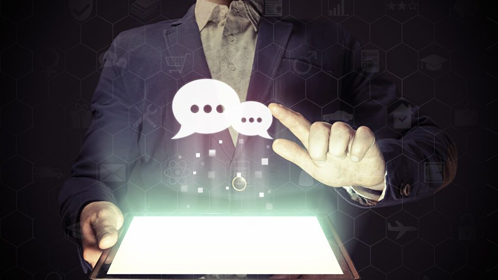 Speech bubbles coming out of computer