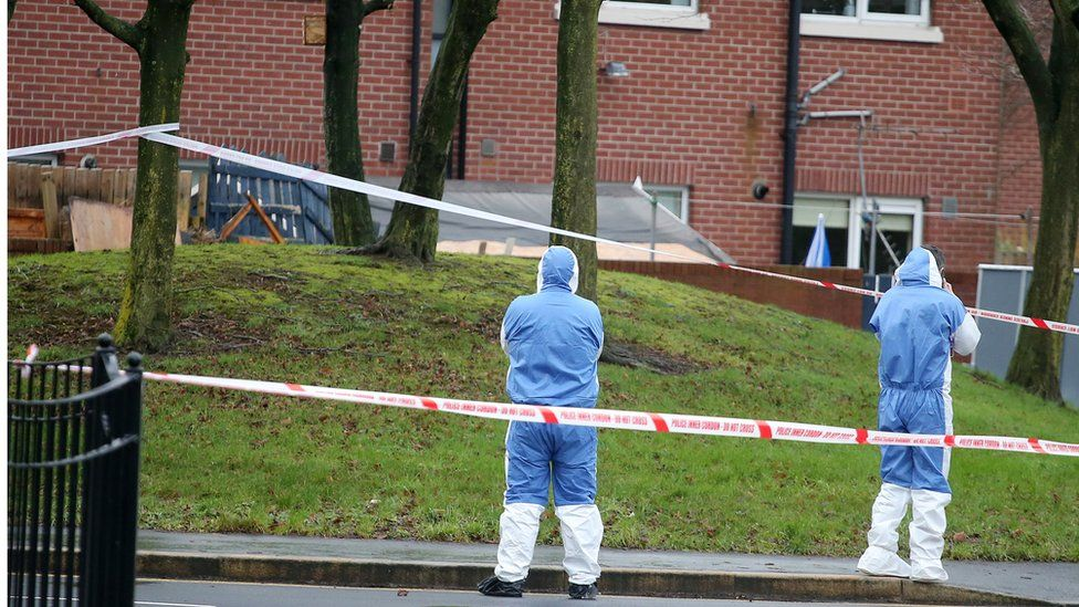 Forensic officers examining scene of the explosion in east Belfast