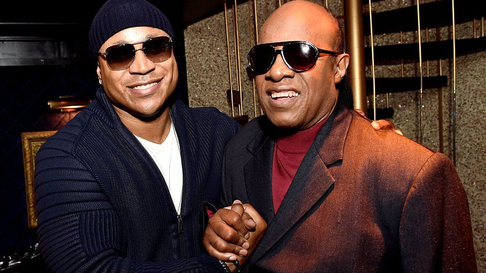 LL Cool J (L) and singer/songwriter Stevie Wonder at the 57th Annual GRAMMY Awards June 16, 2015 in Los Angeles, California.