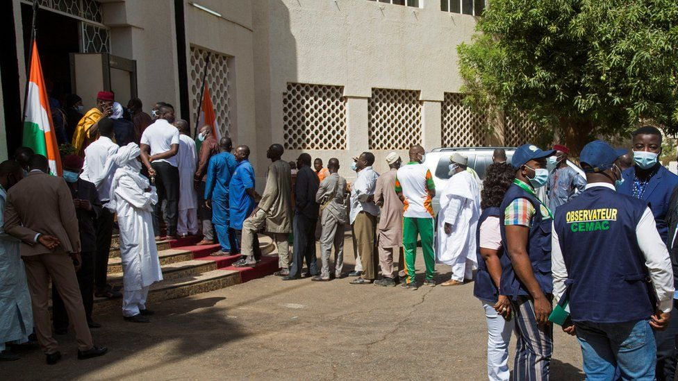Voters queue at a polling station during the second round of the country's presidential election, in Niamey, Niger February 21, 2021.