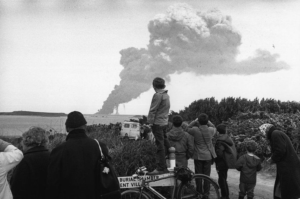 People looking at the smoke