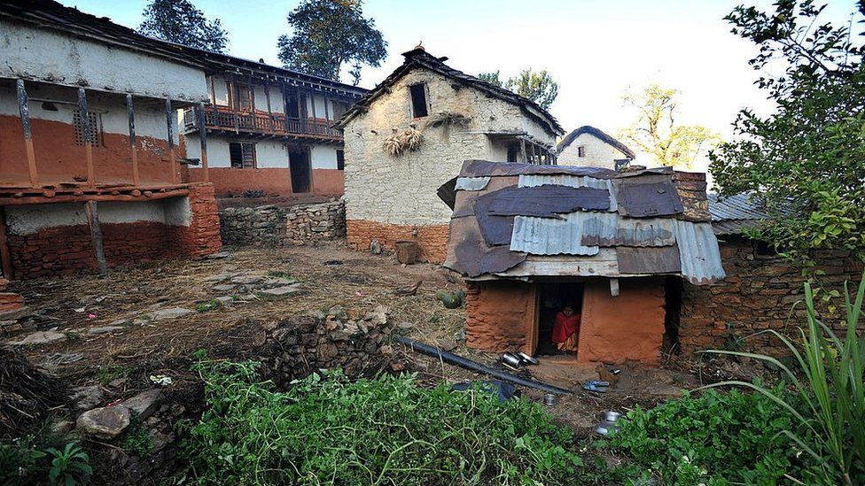 Thirteen year old Nepalese villager Sarswati Biswokarma sits inside a 'chhaupadi house' in the village of Achham, some 800km west of Kathmandu, on 23 November 2011