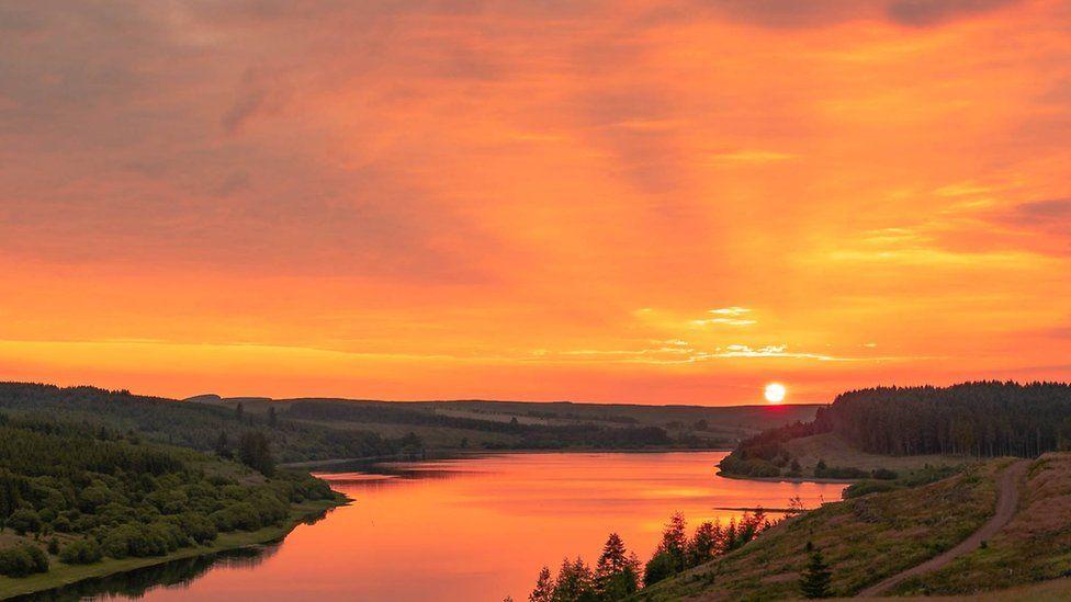 Orange sky over the reservoir
