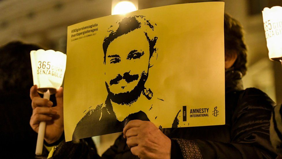 Activists of human rights organization Amnesty International hold a picture of Giulio Regeni on 25 January 2017