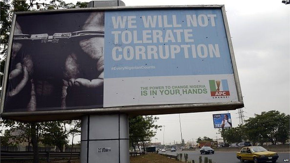 A billboard reading 'We will not tolerate corruption' mounted by the leading opposition All Progressive Congress is seen along a Lagos highway on January 20, 2015.