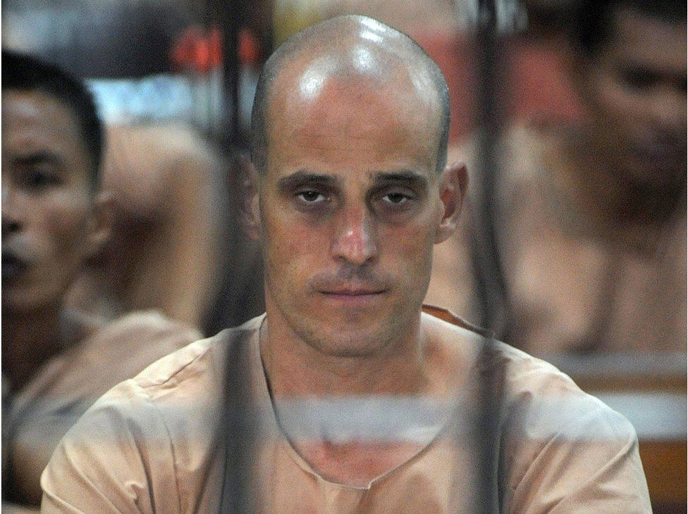 Australian Harry Nicolaides inside a holding cell while waiting for his trial at a court in Bangkok on 19 January 2009.