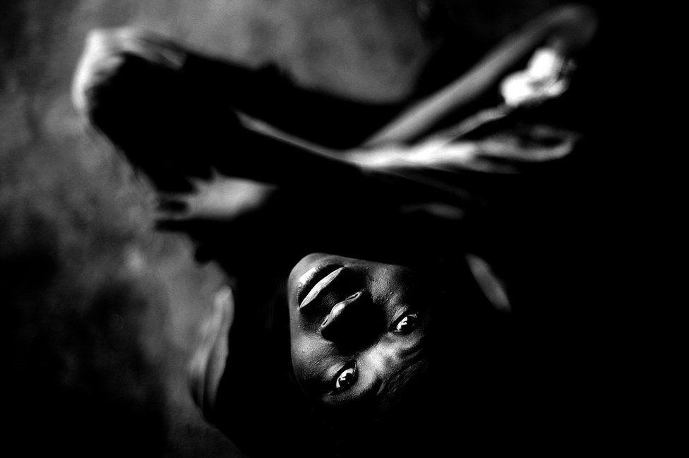 A photograph of a boy by Mario Macilau