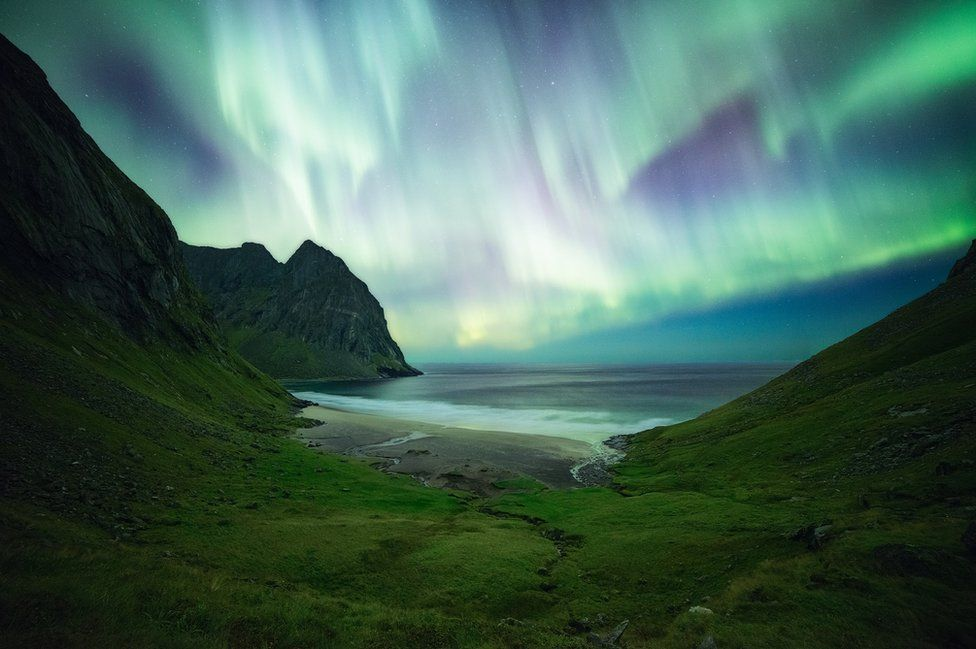 Northern lights above a beach