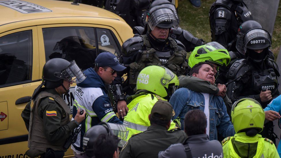 Police arrest a taxi driver during a protest against the private hire company Uber in Bogota, 23 October 2017