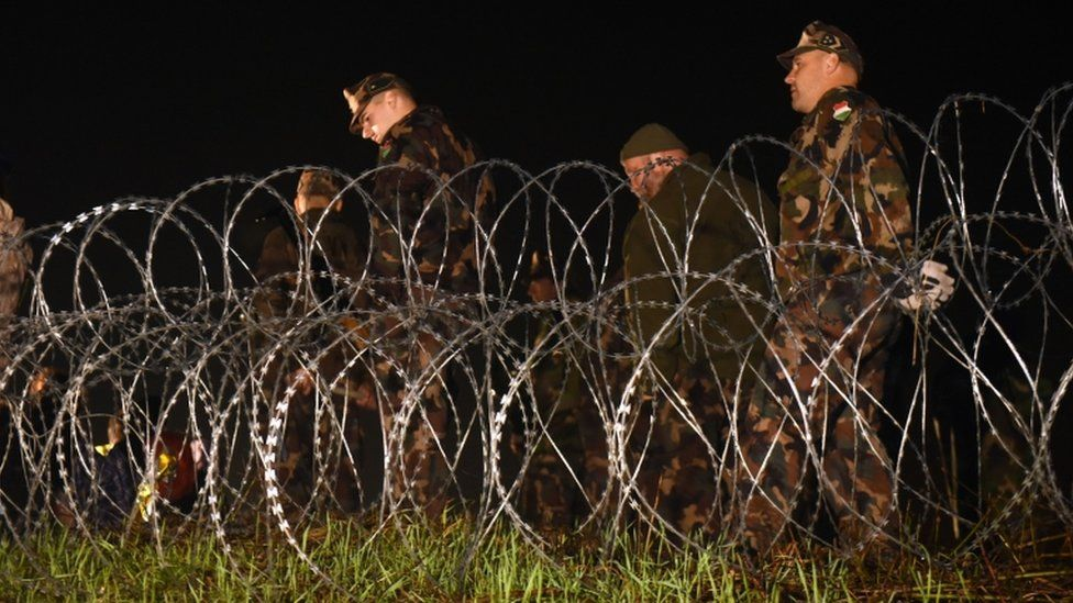 Hungarian police and soldiers close the border between Hungary and Croatia with barbed wire and a fence in Botovo on October 16, 2015.