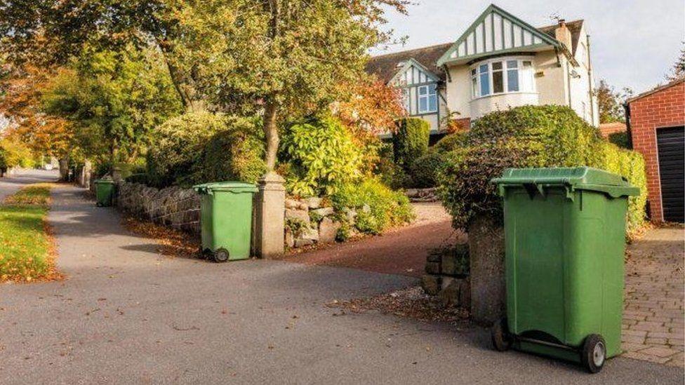 Green bins outside homes in Sheffield