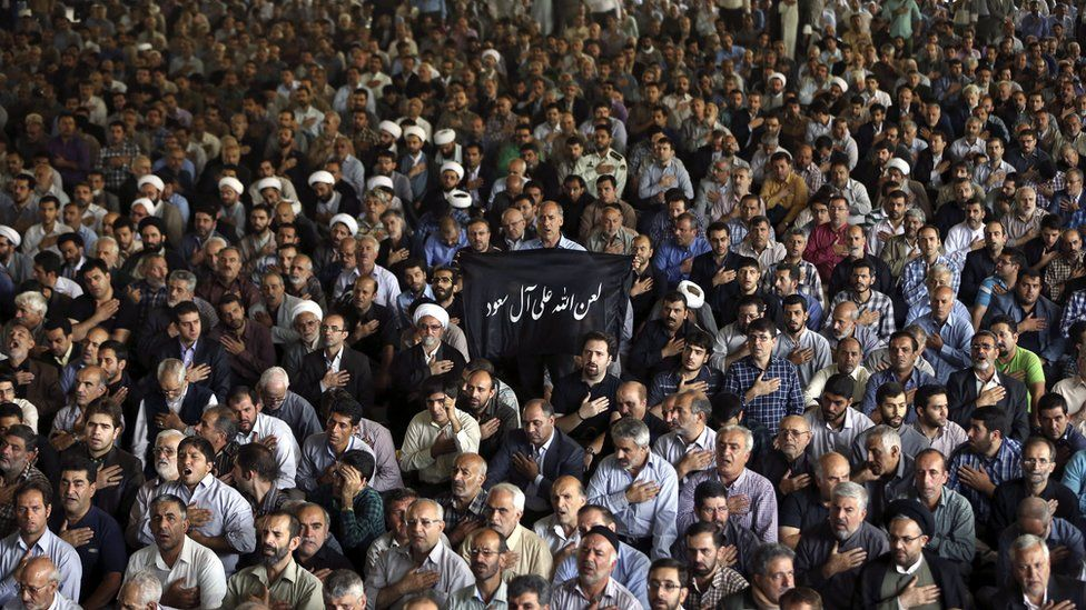 Iranian mourners attend the funeral ceremony of some pilgrims who were killed in a stampede during the hajj pilgrimage in Saudi Arabia last month