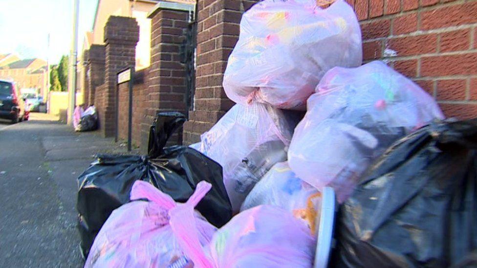 Waste bags on street