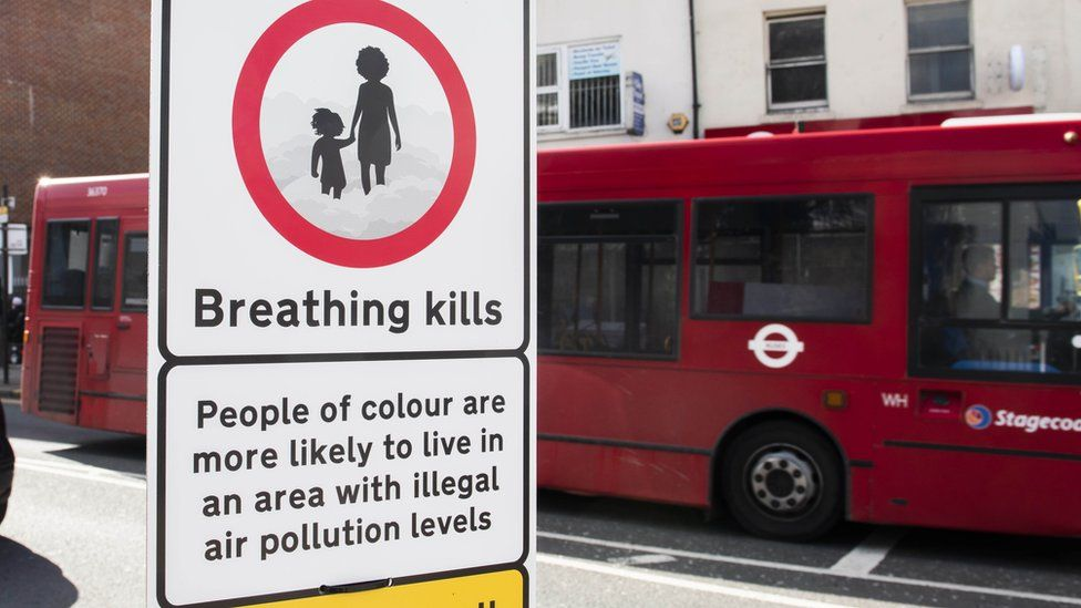 Signs warn that people of colour are more likely to live in areas with high levels of pollution