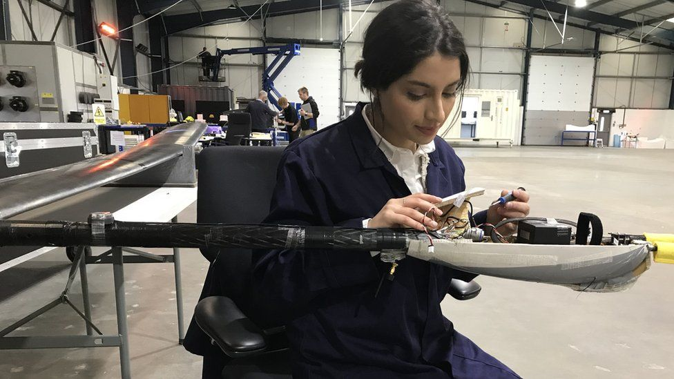 Khadijah Ismail working on camera payload fitting