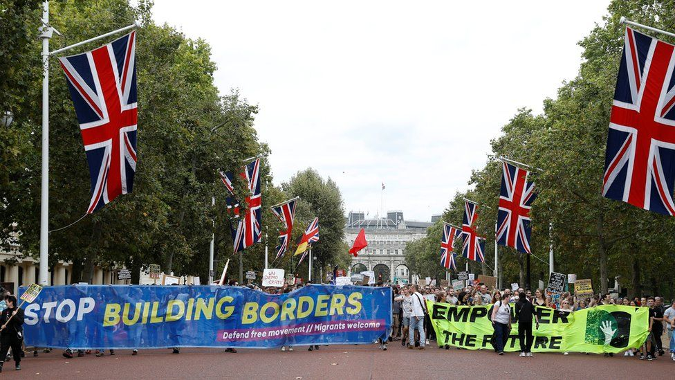 Anti-Brexit protestors walk towards the Buckingham Palace in London, Britain