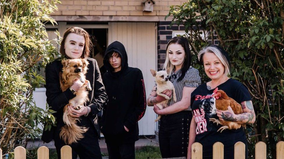 A family-of-four with their dogs