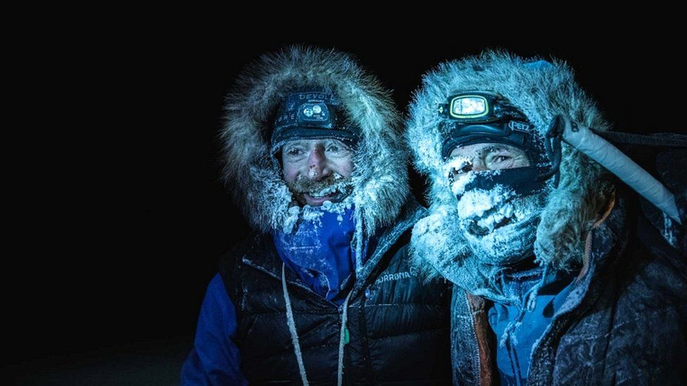 Picture handed out by the Mike Horn Sarl shows Borge Ousland (L) of Norway and South African-born Swiss Mike Horn on 8 December 2019 after arriving at the Lance icebreaker boat in Norwegian waters of the Arctic Ocean