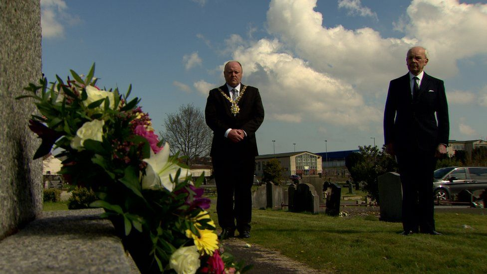 Lord Mayor Frank McCoubrey (centre) laid a wreath at the City Cemetery
