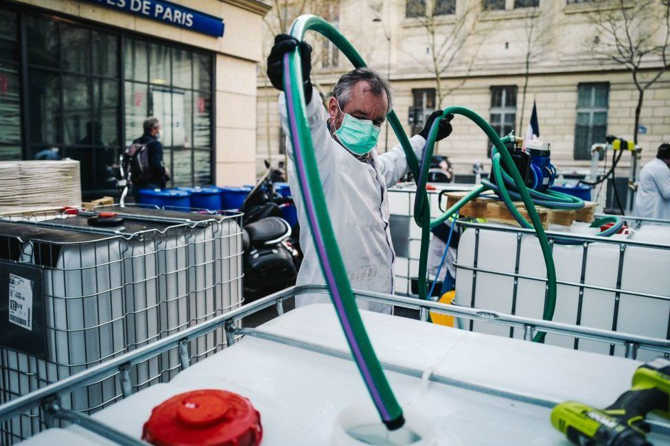A pharmacy in Paris's Latin Quarter has started making sanitiser in the street