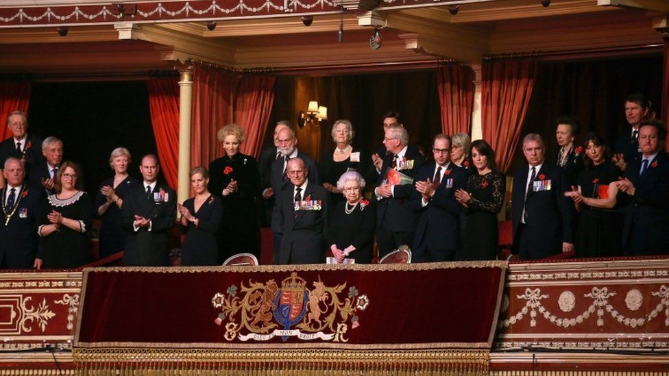 the Royal Box and guests stand as the Chelsea Pensioners arrive at the Royal Albert Hall