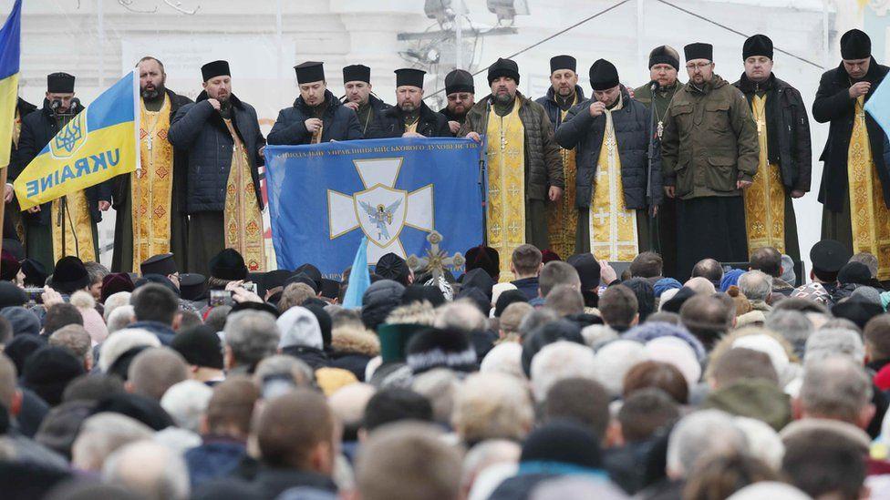 Ukrainians gather outside Saint Sophia's Cathedral in Kiev