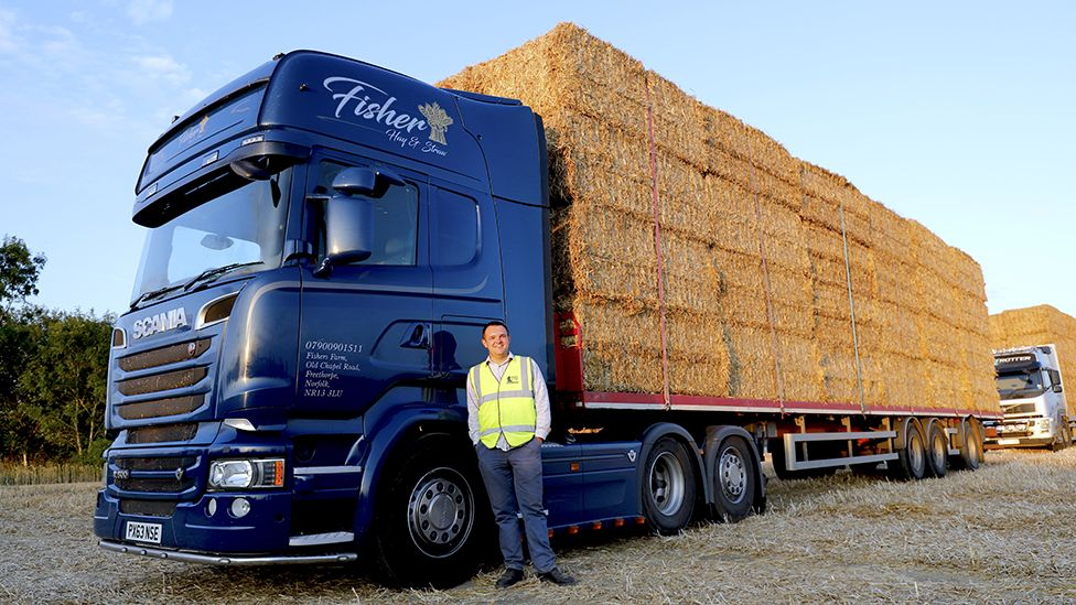 Jack Fisher standing in front of his lorry