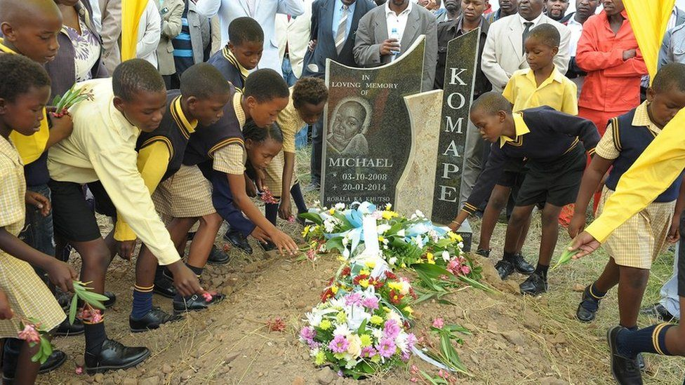 Friends and family attend Michael Komape's burial