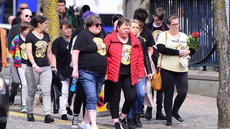 friends of Ms mckee arrive wearing lyra hufflepuff tshirts