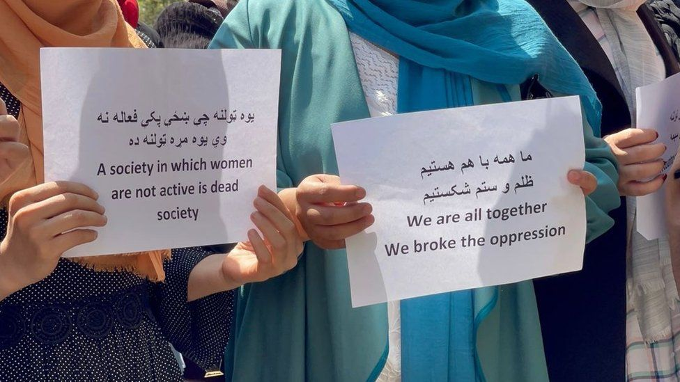 """""""We are all together, we broke the oppression"""" - signs at protest in Kabul"""