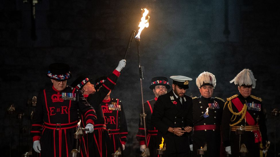 The first torch is lit in a ceremony to mark armistice day at the Tower of London