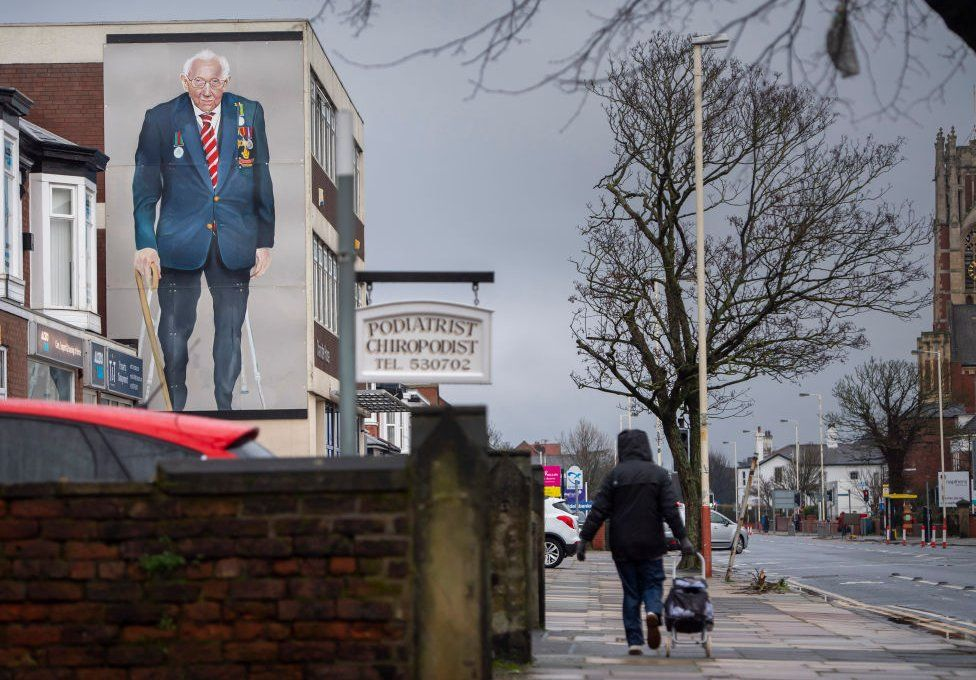 A mural of Capt Sir Tom in Southport