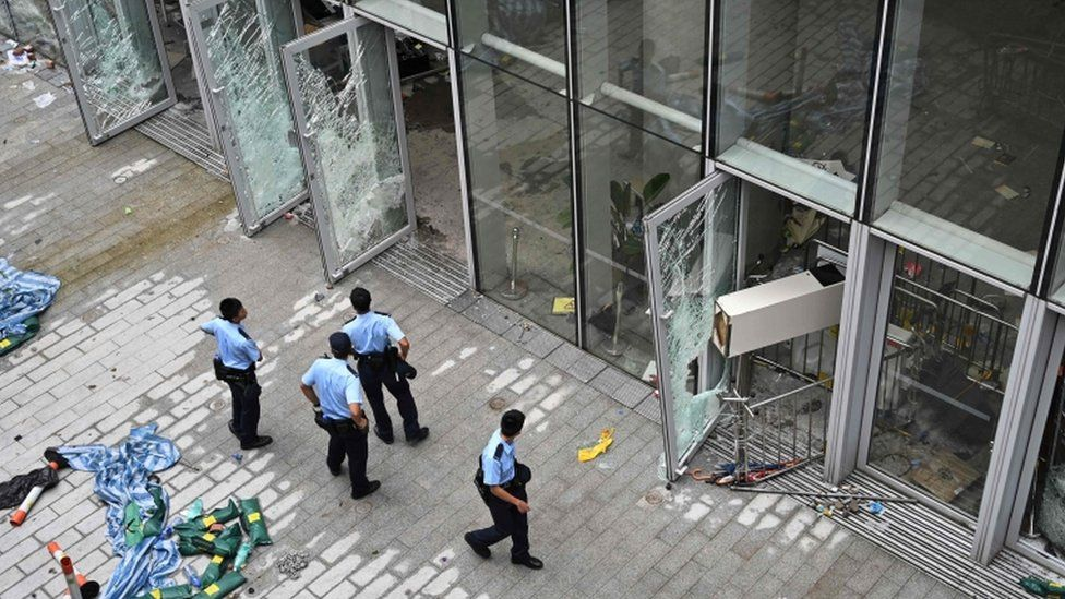 Police stand outside the Legislative Council building in Hong Kong