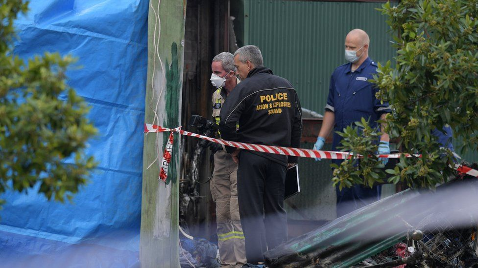 Police arson and explosives squad staff at the scene of the factory fire in Footscray, Melbourne, Victoria, Australia, 2 March 2017.